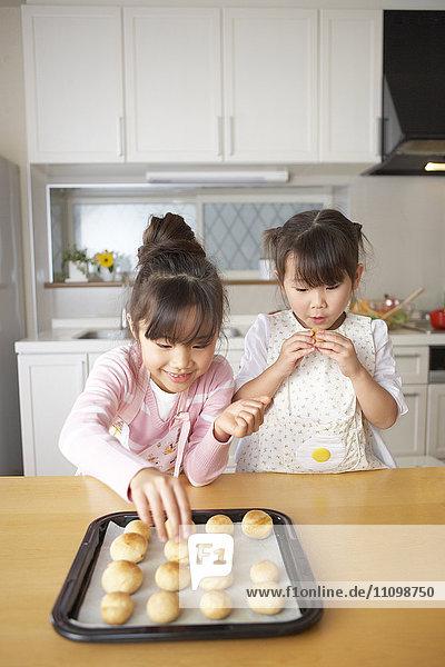 Girls eating bread