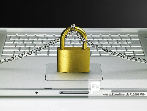 Laptop and padlock