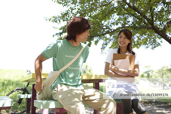 Two students sitting on a bench