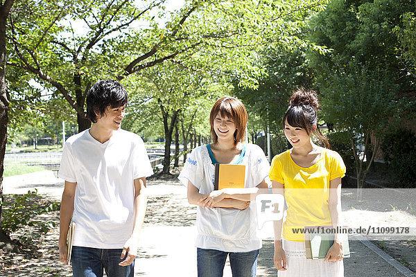 Three students walking outside
