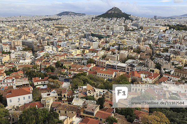 Elevated Athens city view from the Acropolis  towards Lykavittos Hill and Parliament across Plaka and Syntagma  Athens  Greece  Europe
