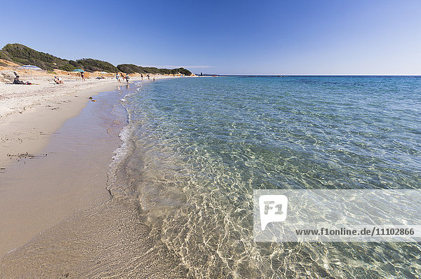The crystal turquoise water of the sea frames the sandy beach  Sant Elmo Castiadas  Costa Rei  Cagliari  Sardinia  Italy  Mediterranean  Europe