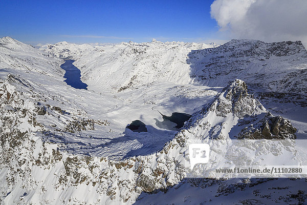 Aerial view of snowy Peak Peloso surrounded by Lago di Lei  Val di Lei Chiavenna  Spluga Valley  Valtellina  Lombardy  Italy  Europe