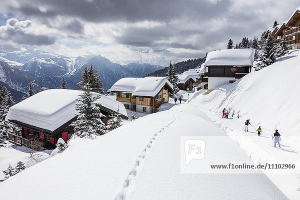Tourists and skiers enjoying the snowy landscape  Bettmeralp  district of Raron  canton of Valais  Switzerland  Europe