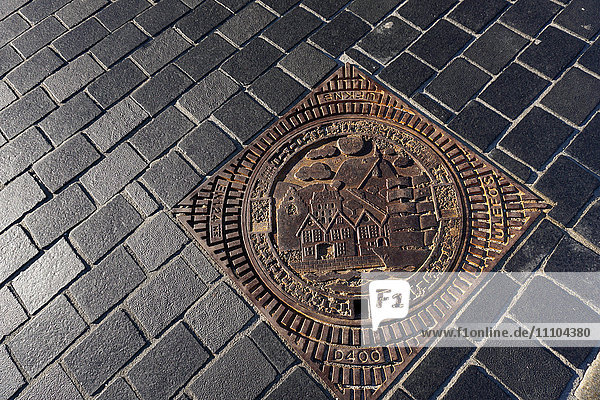 Decorative manhole cover  Bergen  Norway  Hordaland  Norway  Scandinavia  Europe