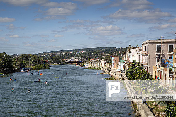 View over people kayaking in Rio San Juan and the city of Matanzas  Cuba  West Indies  Caribbean  Central America