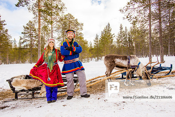 Couple wearing Traditional Sami costumes  Reindeer Safari  Kakslauttanen Igloo Village  Saariselka  Finland  Scandinavia  Europe
