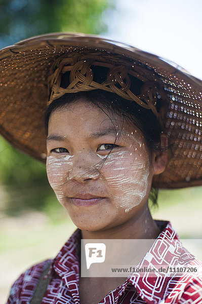 Thanaka cream  ground from tree bark  has been used in Burma for thousands of years  it also acts as protection from the sun  Myanmar (Burma)  Asia