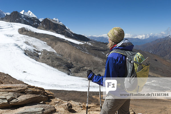 Admiring the view from the top of the Kagmara La  the highest point in the Kagmara Valley at 5115m in Dolpa  Himalayas  Nepal  Asia