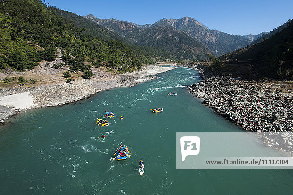 Rafts and kayaks drift down the Karnali River in west Nepal  Asia
