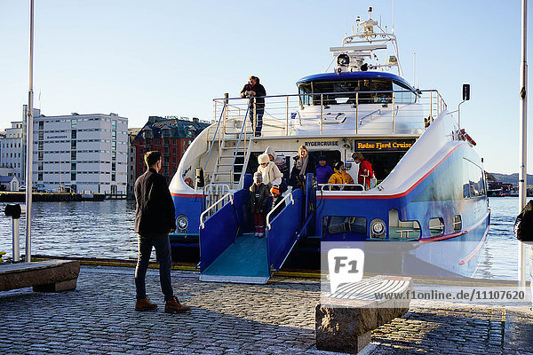 Passengers disembarking from tourist boat for touring Fjords  Bergen  Hordaland  Norway  Scandinavia  Europe