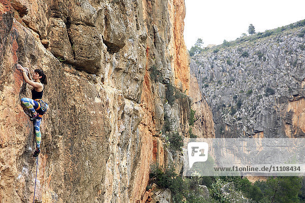 A climber scales cliffs at Chulilla  Valencia  Spain  Europe
