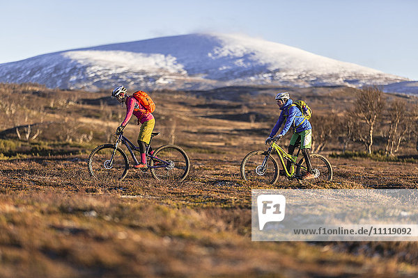 Couple cycling in mountains