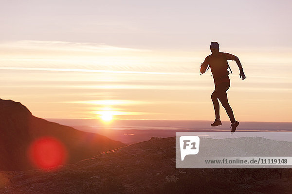 Person jogging at sunset