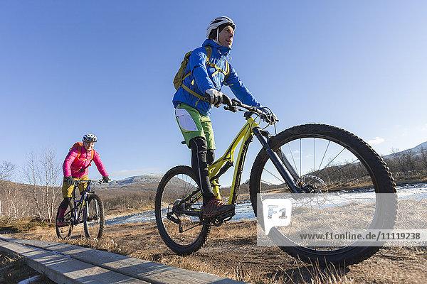 Couple mountain cycling