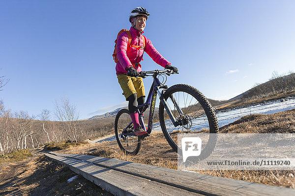 Woman mountain cycling