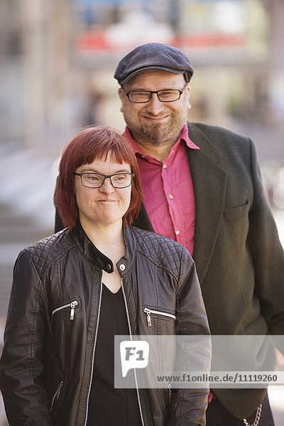 Sweden  Sodermanland  Woman with down syndrome together with boyfriend in street