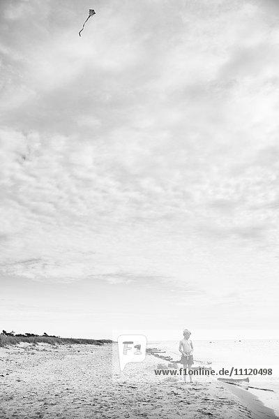 Sweden  Gotland  Shirtless boy (8-9) with kite at beach