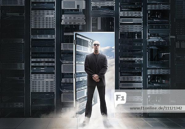 Caucasian man standing in doorway to clouds