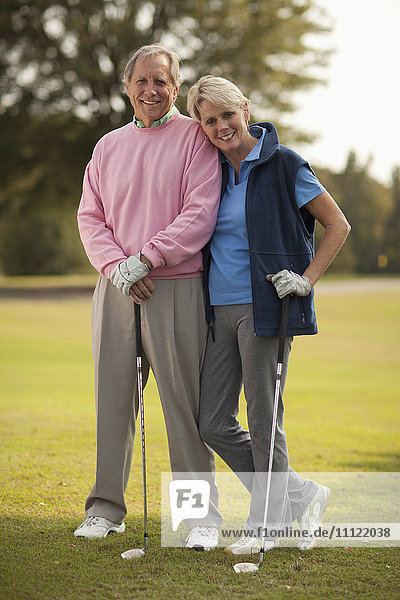 Couple standing on golf course