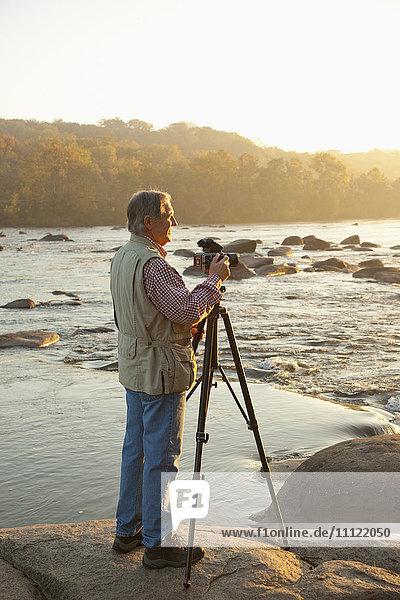 Man taking photographs on beach
