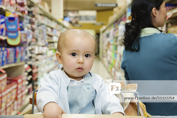 Close up of baby in shopping cart