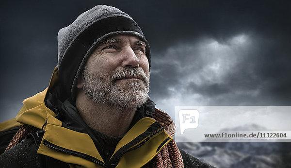 Caucasian man standing in snowy landscape