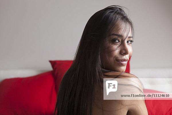 Nude woman looking over her shoulder