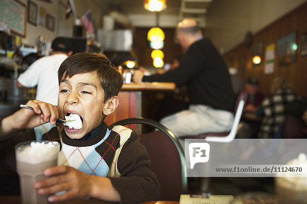 Mixed race boy eating ice cream