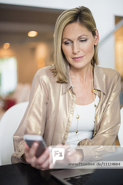 Caucasian woman using cell phone
