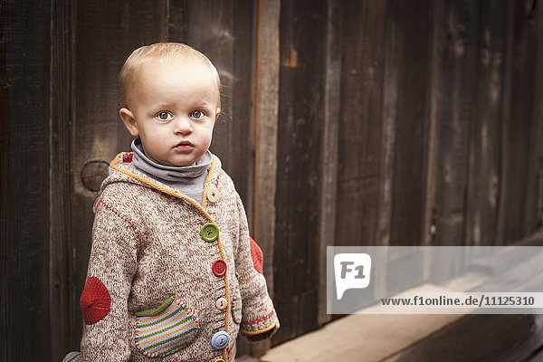 Caucasian boy standing outdoors