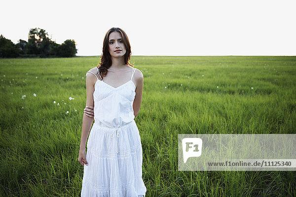 Woman standing in meadow