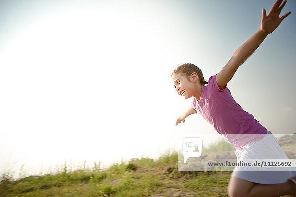 Mixed race girl running outdoors Mixed race girl running outdoors