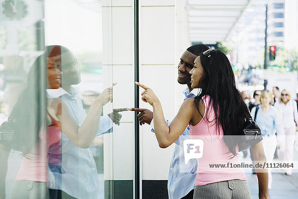 African couple window shopping