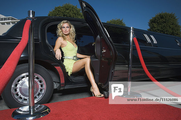 Woman getting out of limousine