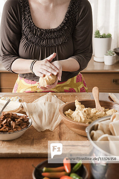 Woman making tamales