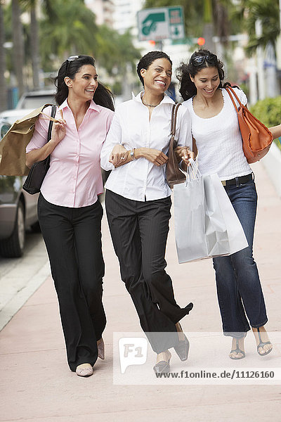 Multi-ethnic women with shopping bags