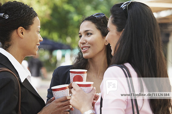 Multi-ethnic friends having coffee