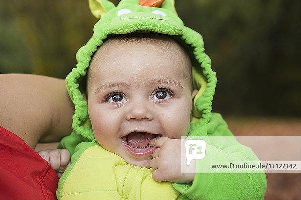 Smiling baby wearing costume, Smiling baby wearing costume