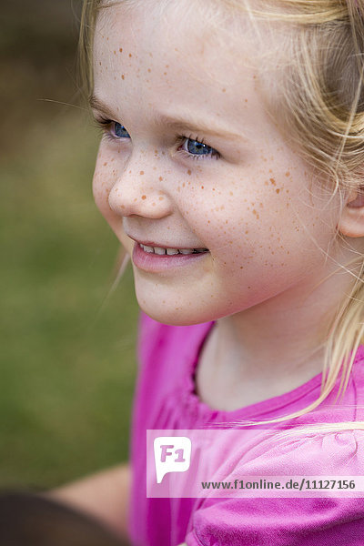 Close up of smiling girl's face