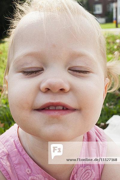 Close up of Caucasian girl's face