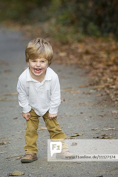 Boy shouting on path