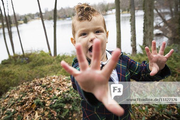 Mixed race boy shouting outdoors