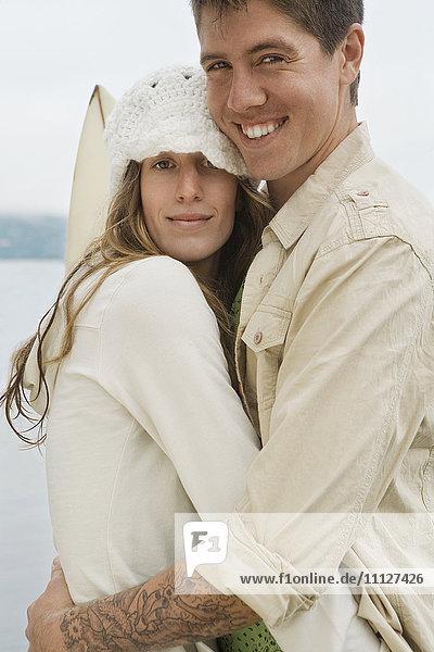 Multi-ethnic couple hugging