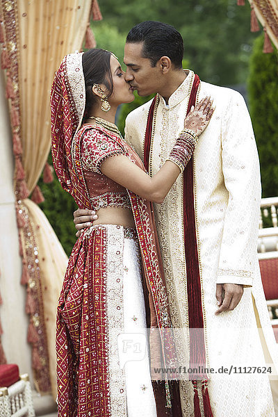 Indian couple in traditional wedding clothing  kissing