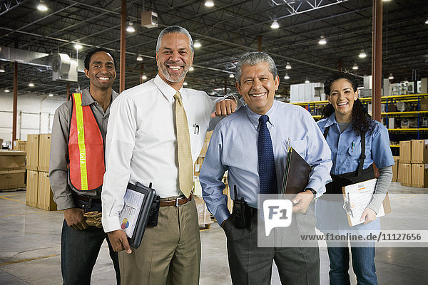 Multi-ethnic co-workers in warehouse