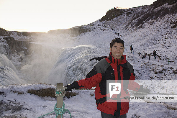 Chinese man standing on remote ice field