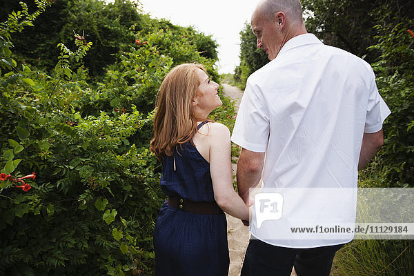 Caucasian couple walking on path outdoors