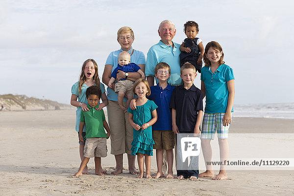 Happy multi-generation family enjoying beach together