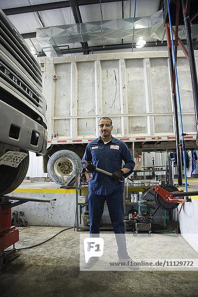 Middle Eastern mechanic in repair shop